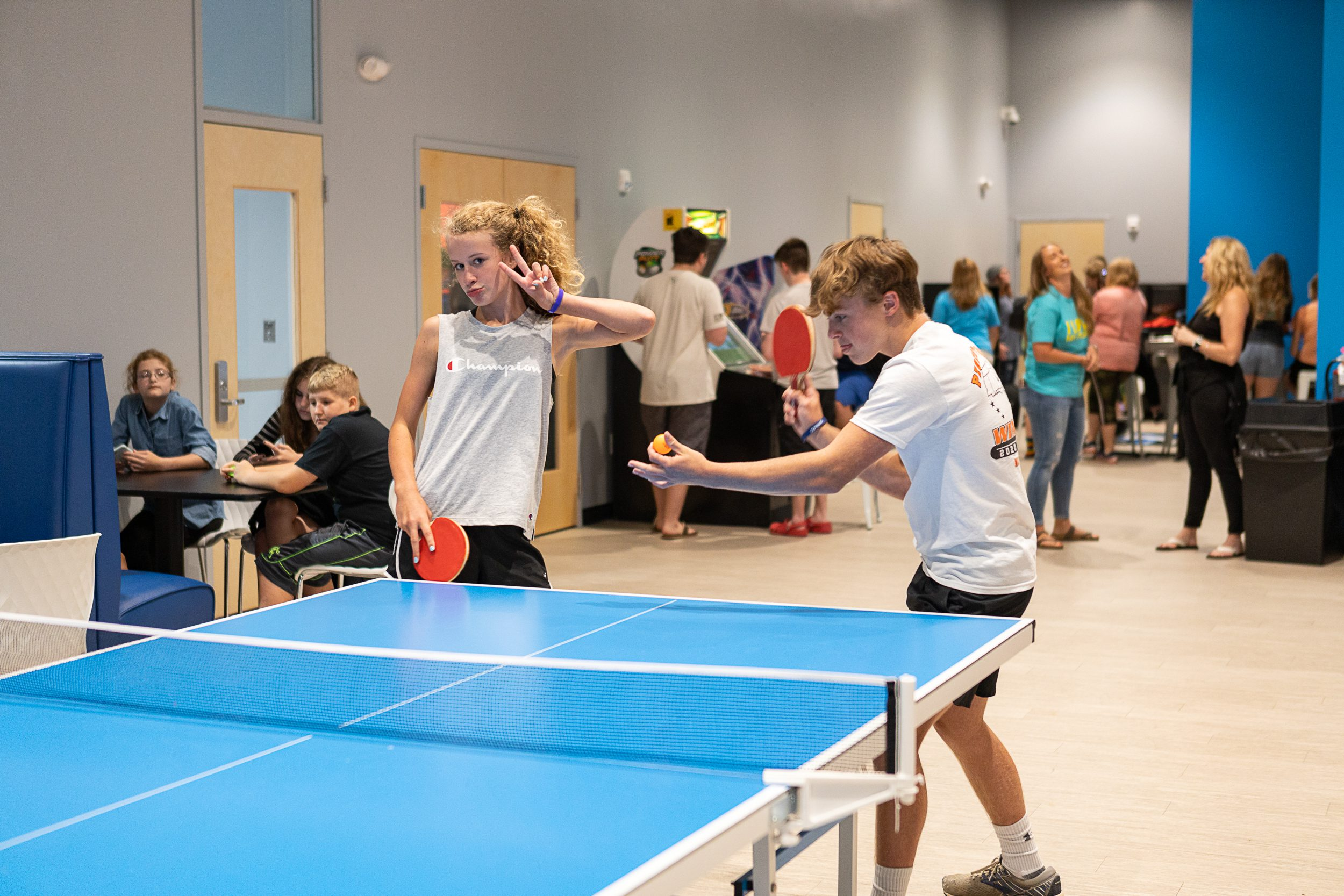 young adults playing ping pong